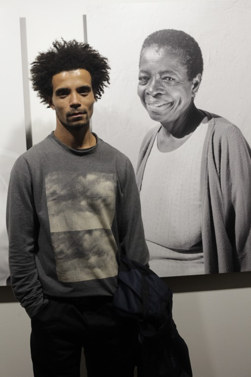 Akala hip hop artist next to portrait of former Black Panther Altheia Jones-LeCointe