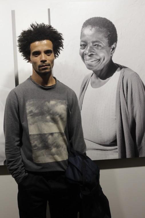 Akala hip hop artist next to portrait of former Black Panther Altheia Jones-LeCointe